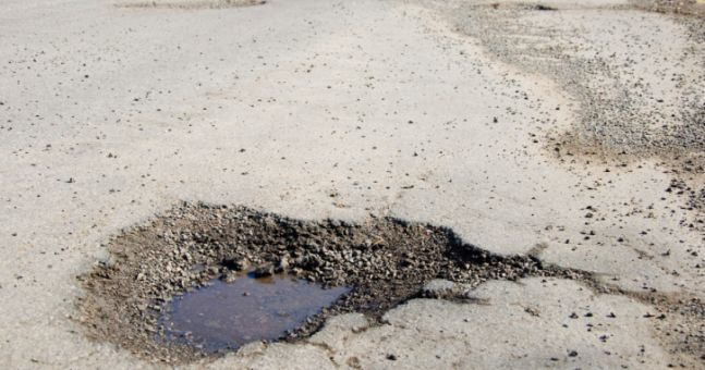 Drastic Action - Woman Proves Her Point By Taking A Bath In A Pothole