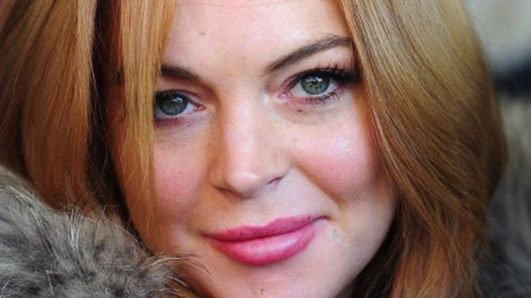 Lindsay Lohan Claims She 'Rolled A Body Bag For Whitney Houston' During Her Community Service