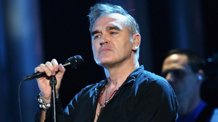 WATCH: Morrissey Escorted Away By Security As Fans Invade The Stage