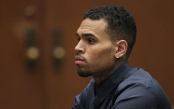 Police surround Chris Brown's home after he allegedly threatened a woman with a gun