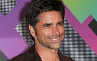 John Stamos and wife Caitlin welcome their first child together