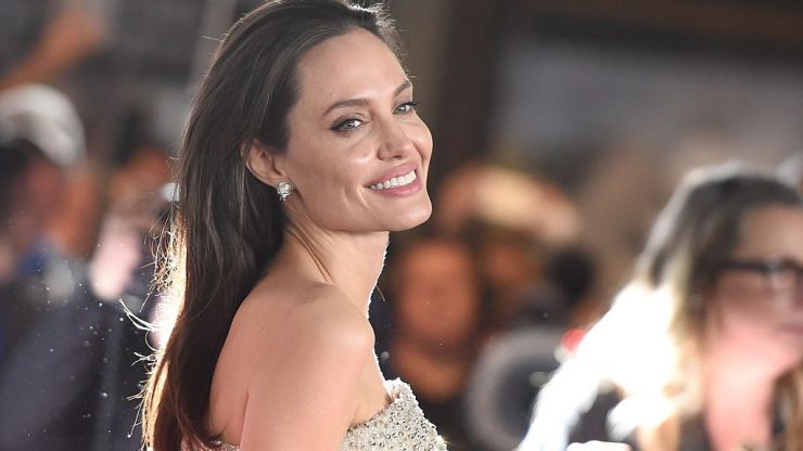 "Angelina Jolie opens up on Brad Pitt split, saying she's ""not there yet"""
