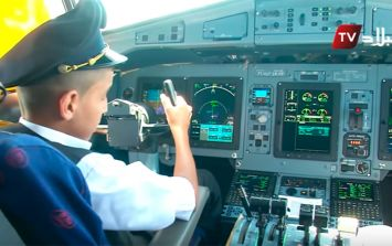 Pilots suspended after allowing young boy to 'fly' passenger plane