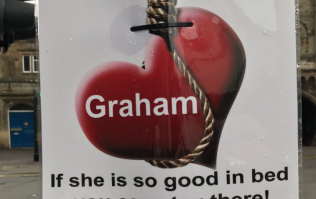 A love-scorned woman has erected these brutal posters about her ex