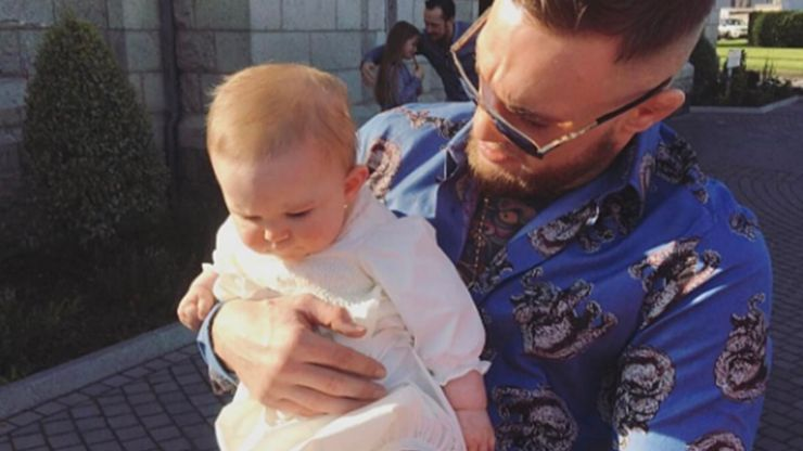 Pregnant Dee Devlin and Conor McGregor share sweet family snaps of nephew's christening