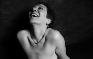 Women show their mastectomy scars to stand up to breast cancer