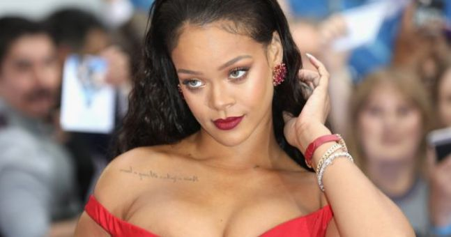 Rihanna just posted a red lip tutorial and she is a total queen