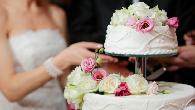The reason why the bride and groom cut the cake together is not OK