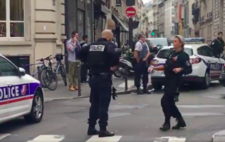 Police on scene as armed man takes hostages in Paris
