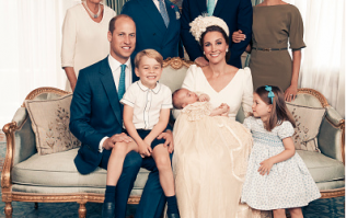 Such a cute moment between Princess Charlotte and Prince Louis at his christening