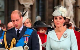 Kate Middleton catches Prince William having a giggle during today's RAF celebration