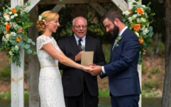 Dog absolutely ruins couple's wedding photo and has a lovely time while he's at it