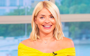 Holly Willoughby is FINALLY back on the telly and her dress is (obviously) GORGEOUS