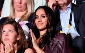 Sorry, what? Meghan Markle was just spotted picking up her dog's poo outside Kensington Palace