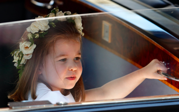 Princess Charlotte looks unimpressed by Prince George's antics in latest snap of the pair