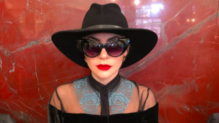 Lady Gaga looks stunning in Milan but all eyes are on her bodyguard