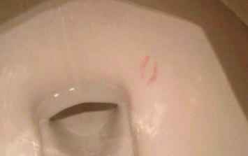 Someone kissed the inside of a toilet bowl and no one can figure out why