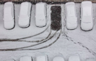 Man builds a car out of snow, police give it a parking ticket
