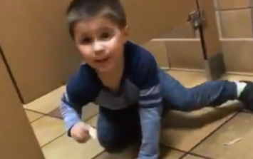 A little boy innocently climbed under a man's bathroom stall while he was using the toilet