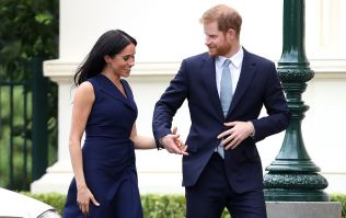 Meghan Markle shows off her growing baby bump in gorgeous blue dress