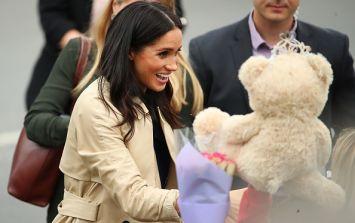 Meghan breaks royal protocol taking a snap with a fan who looks like her