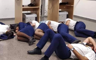 Six Ryanair crew have lost their jobs after staging a photo sleeping on an airport floor