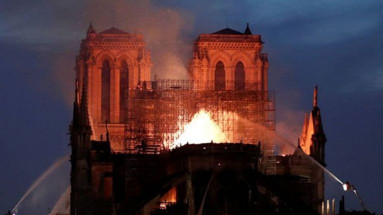 French President Emmanuel Macron pledges to rebuild Notre Dame