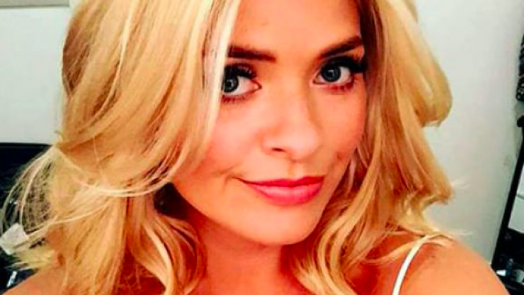 Holly Willoughby is wearing the most DIVINE yellow midi skirt this morning