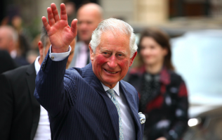 Prince Charles looked the picture of happiness while talking about his new grandson today