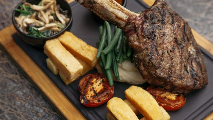 WIN a delicious tomahawk steak dinner for two at 1900 Restaurant
