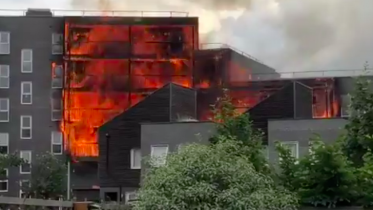 A hundred firefighters are battling a massive fire at block of flats in east London