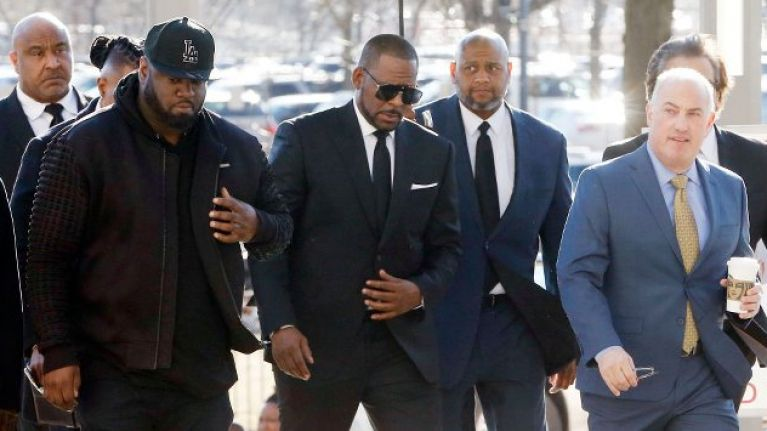 R Kelly arrested on charges of federal sex trafficking