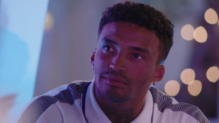 Michael sat under a giant 'cheat' sign on Love Island