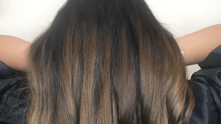 The Gold Obsidian trend is the perfect subtle update for your dark hair this summer