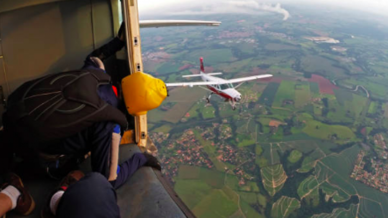 Woman survives one mile fall from airplane after parachute fails to open