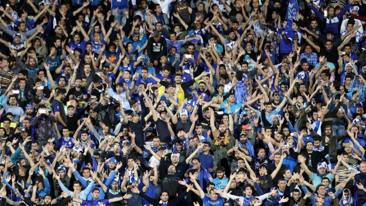 Iranian female football fan facing prison dies after lighting herself on fire