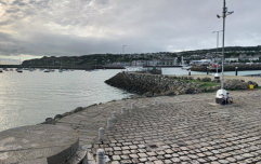 Man rescued from water and taken to hospital after car drives off Howth pier