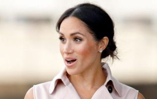 Meghan Markle just arrived in Morocco wearing the most STUNNING red dress ever