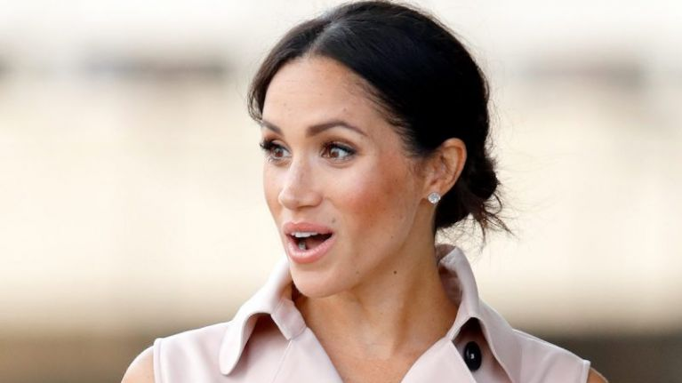 Meghan Markle just stepped out wearing all white, looking like an actual ANGEL