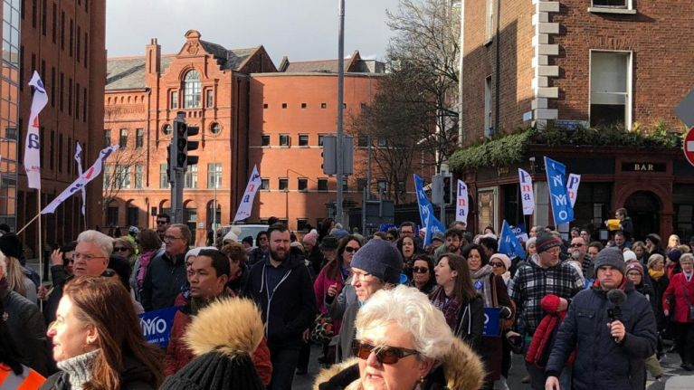 Thousands of people march through Dublin in support of striking nurses and midwives