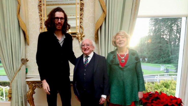 Hozier switches on Christmas lights with Michael D, is very tall while doing so