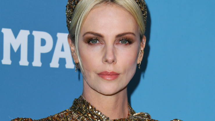 Charlize Theron looked like a golden goddess at last night's Costume Designers Guild Awards