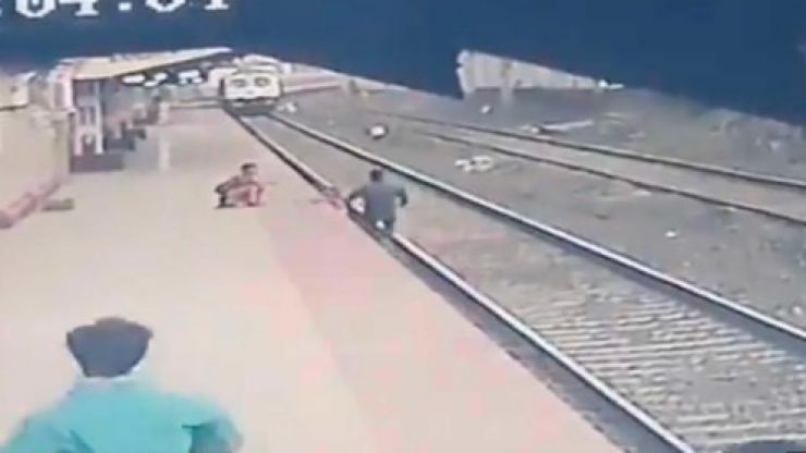 WATCH: Heroic Indian rail worker saves child from tracks as train approaches