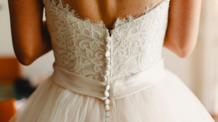 Bride disinvites woman from wedding, still wants to wear her dress