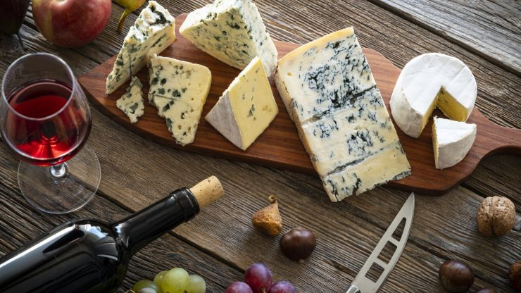 You can now get paid to eat wine and cheese for Christmas