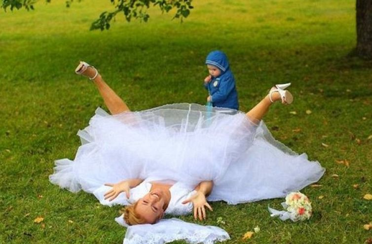 Wedding photobomb #8: This stray child intent on photobombing the wedding shots got WAY more than he bargained for.