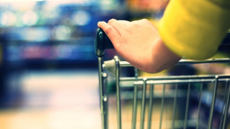 6 year old boy has great fun with his parents shopping list