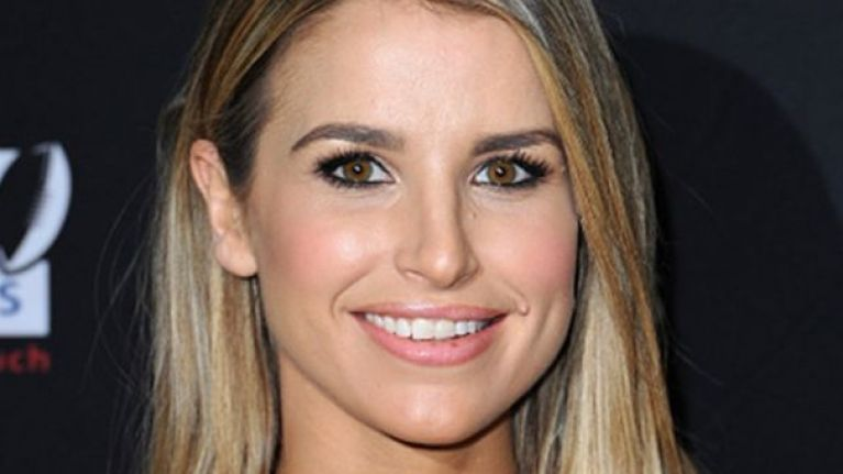 Glowing Vogue Williams shows off her bare bump on Irish magazine cover