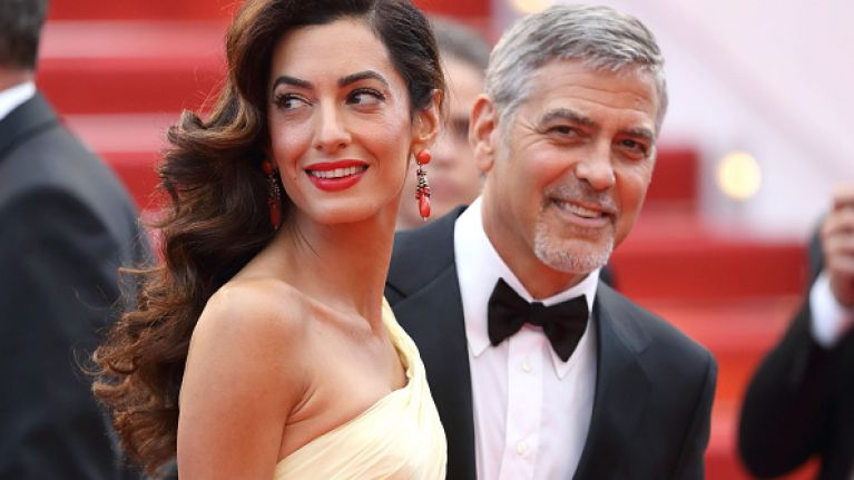 Amal and George Clooney beef up security to protect twins