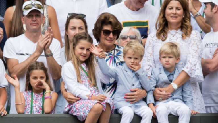 Mirka Federer brings all four kids to Wimbledon... AND she wears white